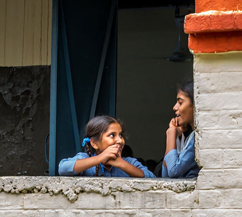 School girls engage in conversation