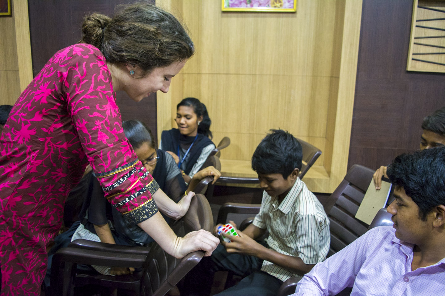 Teacher interacting with children in classroom at a school in India